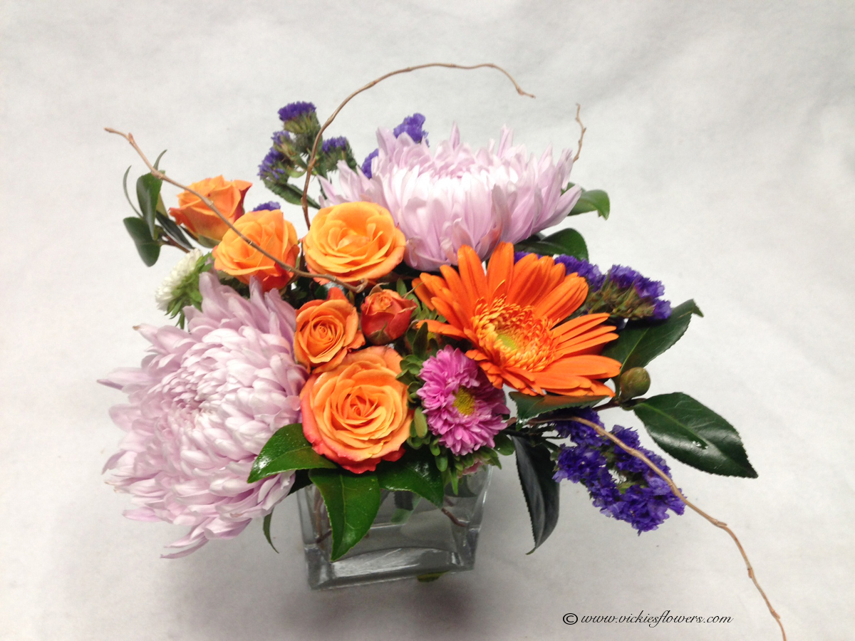 Birthday anniversary thank you congratulations vickies flowers bouquet u 002 45 plus tax and delivery purple mums and orange spray roses with one gerber daisy in clear glass vase izmirmasajfo