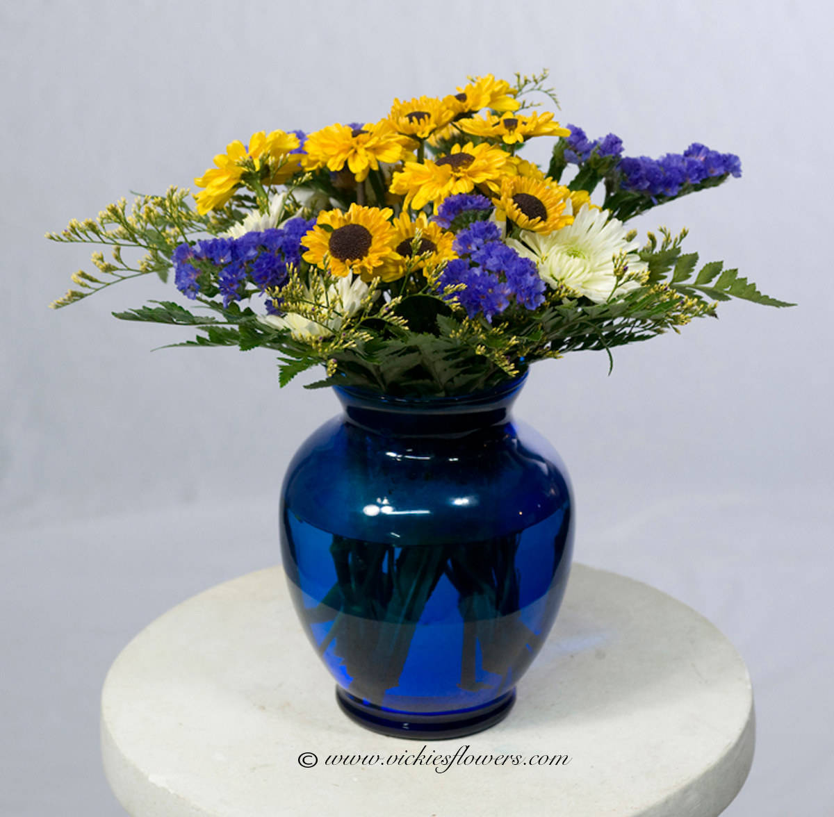 Birthday anniversary thank you congratulations vickies flowers bouquet u 012 45 plus tax and delivery classic bright and cheery sunflowers white mums and delphinium in cobalt blue vase izmirmasajfo Image collections