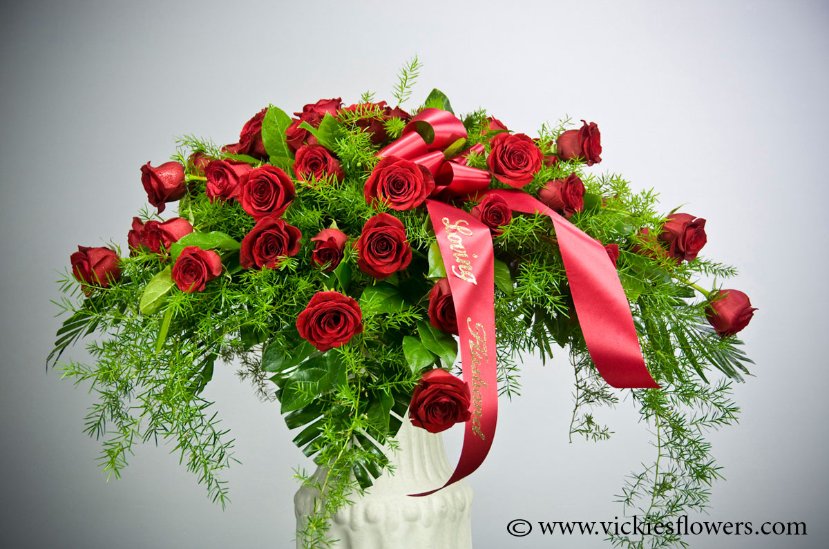 Casket sprays delivered daily vickies flowers brighton co florist casket spray 015 300 plus tax and delivery brilliant red casket spray made with red carnations wax flower and fox tail includes custom red lettered izmirmasajfo Image collections