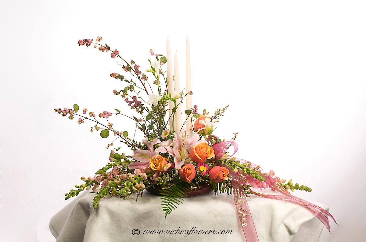 Cremation urn funeral flowers vickies flowers brighton co florist cremation funeral flowers 013 150 plus tax and delivery pink and orange cremation arrangement with three tall candles that can be lit during ceremony izmirmasajfo