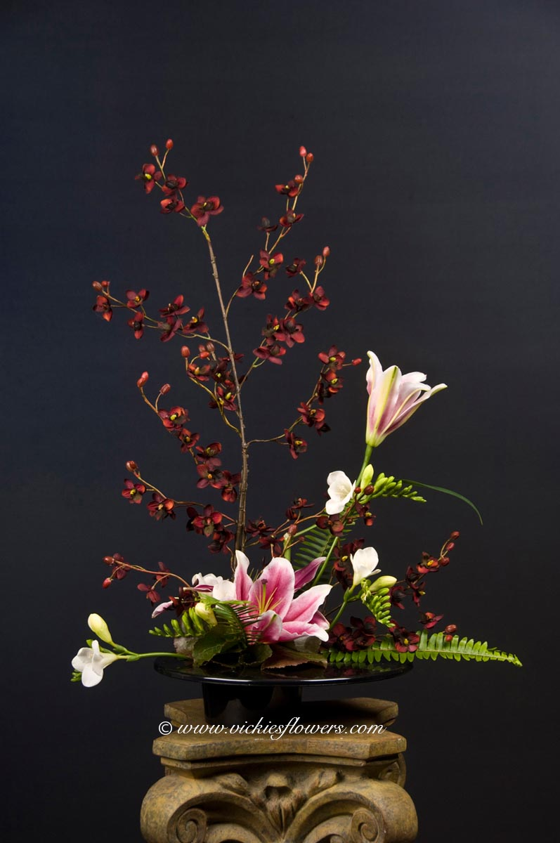 Cremation urn funeral flowers vickies flowers brighton co florist cremation funeral flowers 014 85 plus tax and delivery ikebana funeral flower arrangement with stargazer lilies white freesia and kangaroo paws izmirmasajfo Image collections