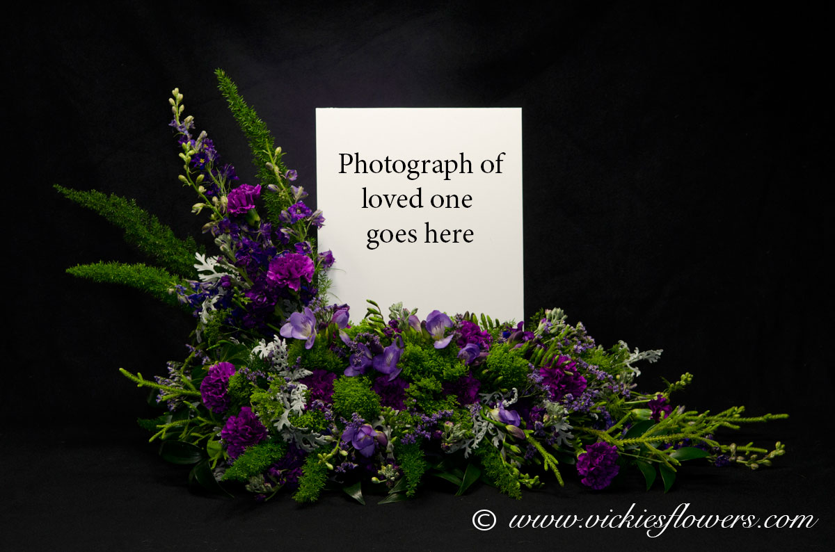 Cremation urn funeral flowers vickies flowers brighton co florist cremation funeral flowers 023 275 plus tax and delivery our very popular purple cremation with photograph arrangement photograph of your loved on is izmirmasajfo