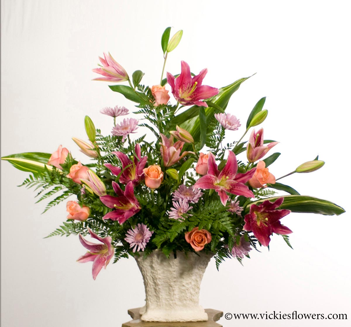 Sympathy flowers and plants vickies flowers brighton co florist funeral sympathy flowers 007 150 plus tax and delivery beautiful asiatic lily arrangement with peach roses lavender daisy mums aspidistra izmirmasajfo