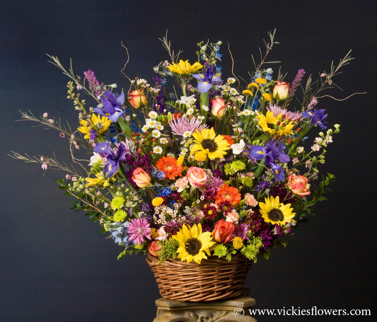 Sympathy flowers and plants vickies flowers brighton co florist funeral sympathy flowers 017 295 large basket 300 plus tax and delivery large basket of mixed wild flowers including blue iris yellow sunflowers izmirmasajfo Choice Image