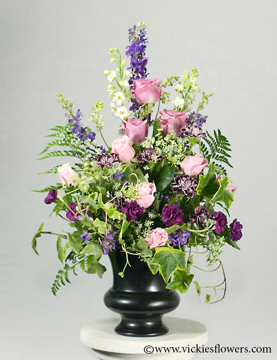 Sympathy flowers and plants vickies flowers brighton co florist funeral sympathy flowers 025 125 plus tax and delivery lavender roses purple carnations purple and white larkspur and ivy in a black urn container izmirmasajfo