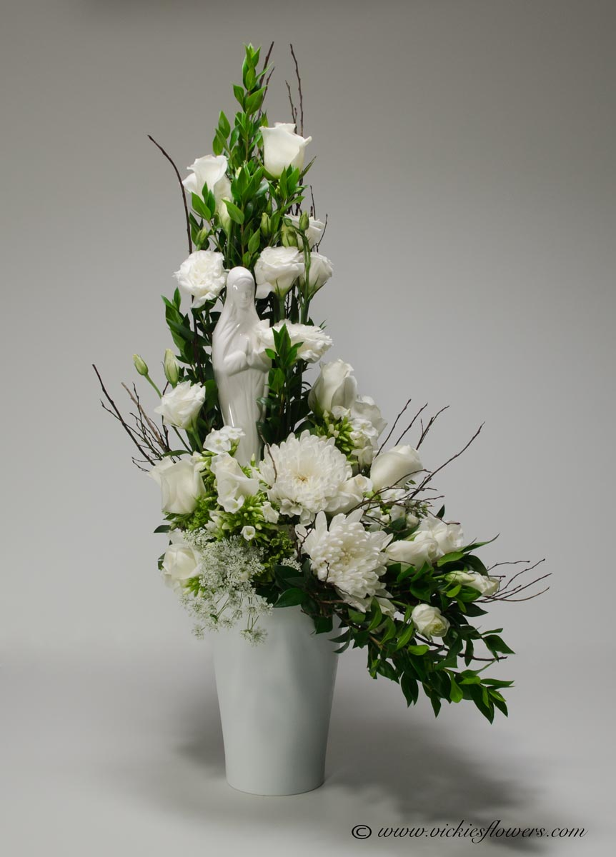 Sympathy flowers and plants vickies flowers brighton co florist funeral sympathy flowers 033 150 plus tax and delivery poker themed funeral flowers with playing cards withe roses lavender roses bells os ireland izmirmasajfo