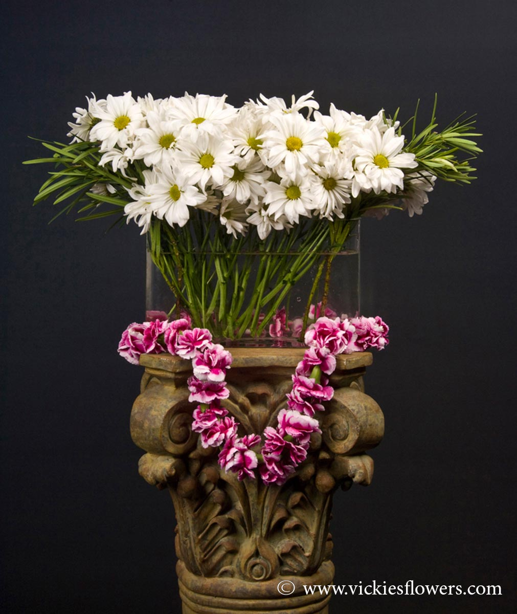 Sympathy flowers and plants vickies flowers brighton co florist funeral sympathy flowers 035 155 plus tax and delivery tropical large hawaiian themed arrangement with white daisies in clear glass oblong vase izmirmasajfo Image collections