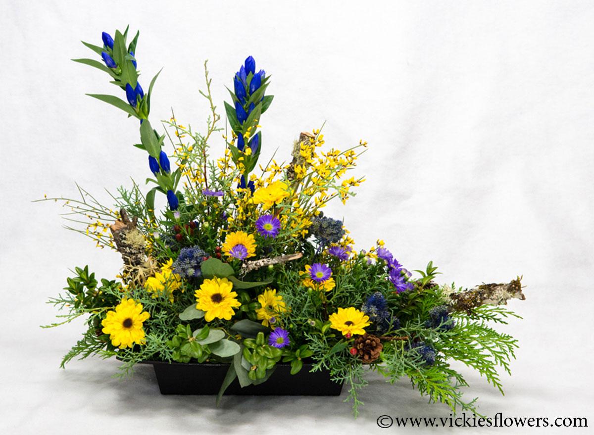 Sympathy flowers and plants vickies flowers brighton co florist funeral sympathy flowers 003 175 plus tax and delivery yellow blue and green mountain wild flower funeral tribute with protea daisies mums pine izmirmasajfo