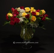 Mothers-Day-Flowers-010 $190 (plus tax and delivery) Large bouquet of 36 mixed color Roses in a keepsake glass vase.