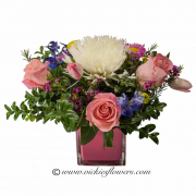 Mothers-Day-Flowers-001 $65 (plus tax and delivery) Mixed pink Roses, white Mums,  Blue Delphinium, and pink Tulips in a keepsake pink vase.