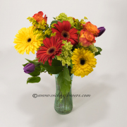 Mothers-Day-Flowers-004 $75 (plus tax and delivery) Gerber Daisies with Circus Roses, green Hydrangea, and Tulips.