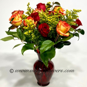 Mothers-Day-Flowers-012 $65 (plus tax and delivery) One dozen mixed Roses in a red glass vase.