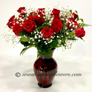 Mothers-Day-Flowers-011$125 (plus tax and delivery) Two dozen Roses in red glass vase.