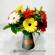 Mothers-Day-Flowers-013 $75 (plus tax and delivery) Unique keepsake tin metal flower piture filled with Gerber Daisies.