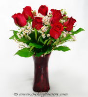 Mothers-Day-Flowers-006  $65 (plus tax and delivery)  12 red, pink. or yellow Roses arranged in a red glass tapered vase.
