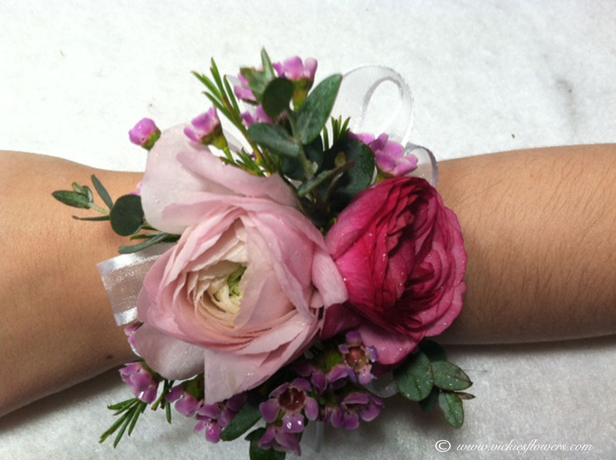Corsage boutonnieres prom homecoming vickies flowers brighton prom 010 35 plus tax and delivery pink wrist corsage with pink ranunculus and pink wax flower accented with white laced ribbon mightylinksfo