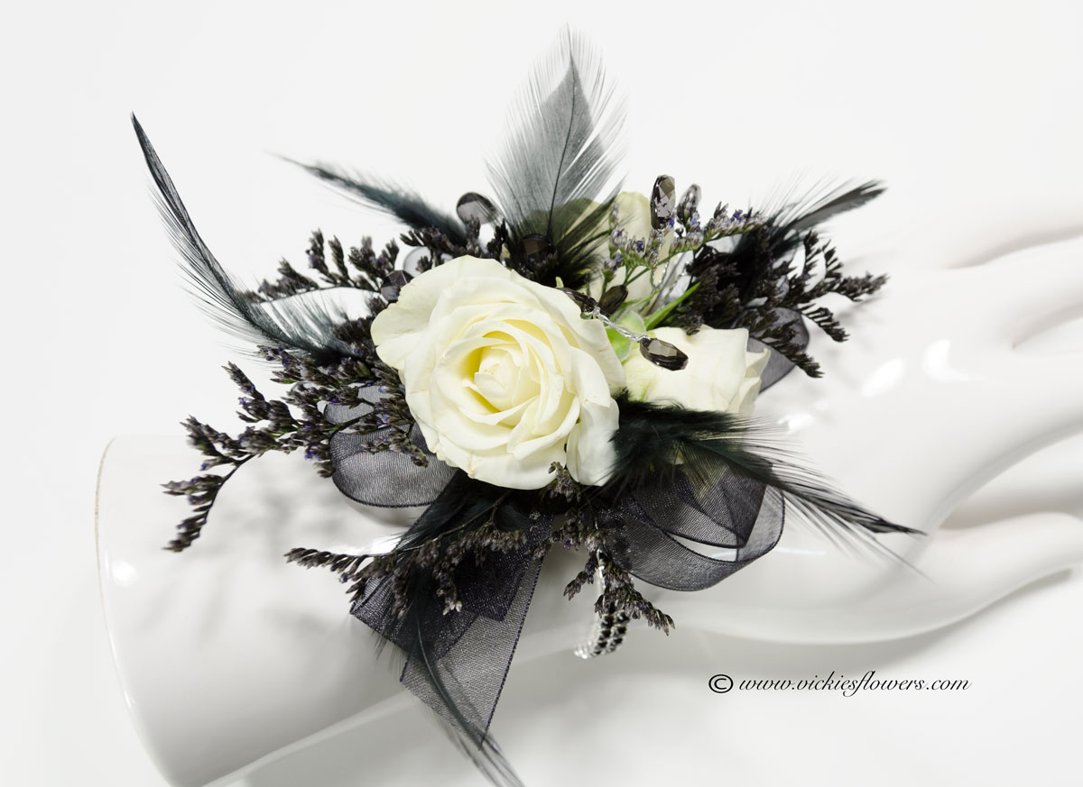 Corsage boutonnieres prom homecoming vickies flowers brighton prom 022 45plus tax and delivery black and white wrist corsage with white spray roses black feathers black ribbon black stones and black limonium mightylinksfo