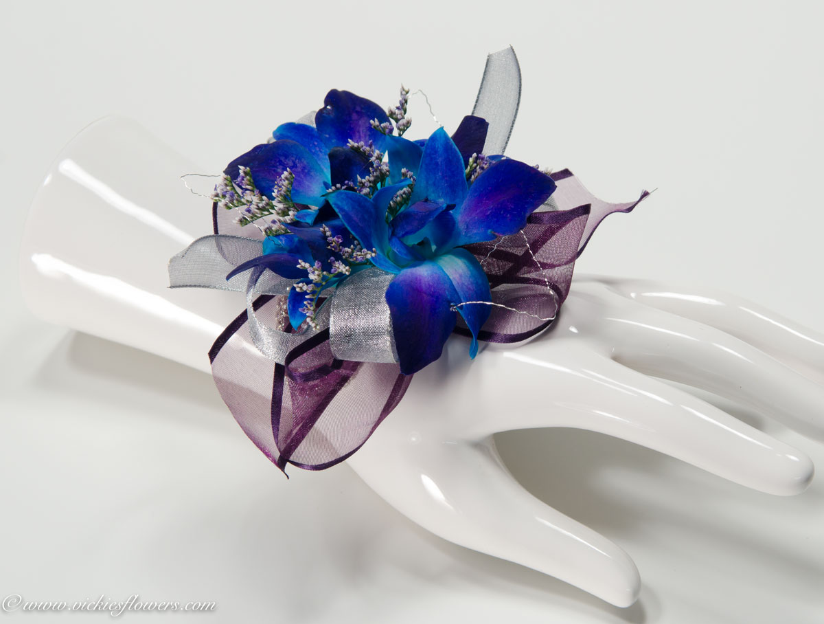Corsage boutonnieres prom homecoming vickies flowers brighton prom 025 40 plus tax and delivery blue orchid wrist corsage with purple and silver sheer ribbon limonium and silver wire on a studded wrist band izmirmasajfo