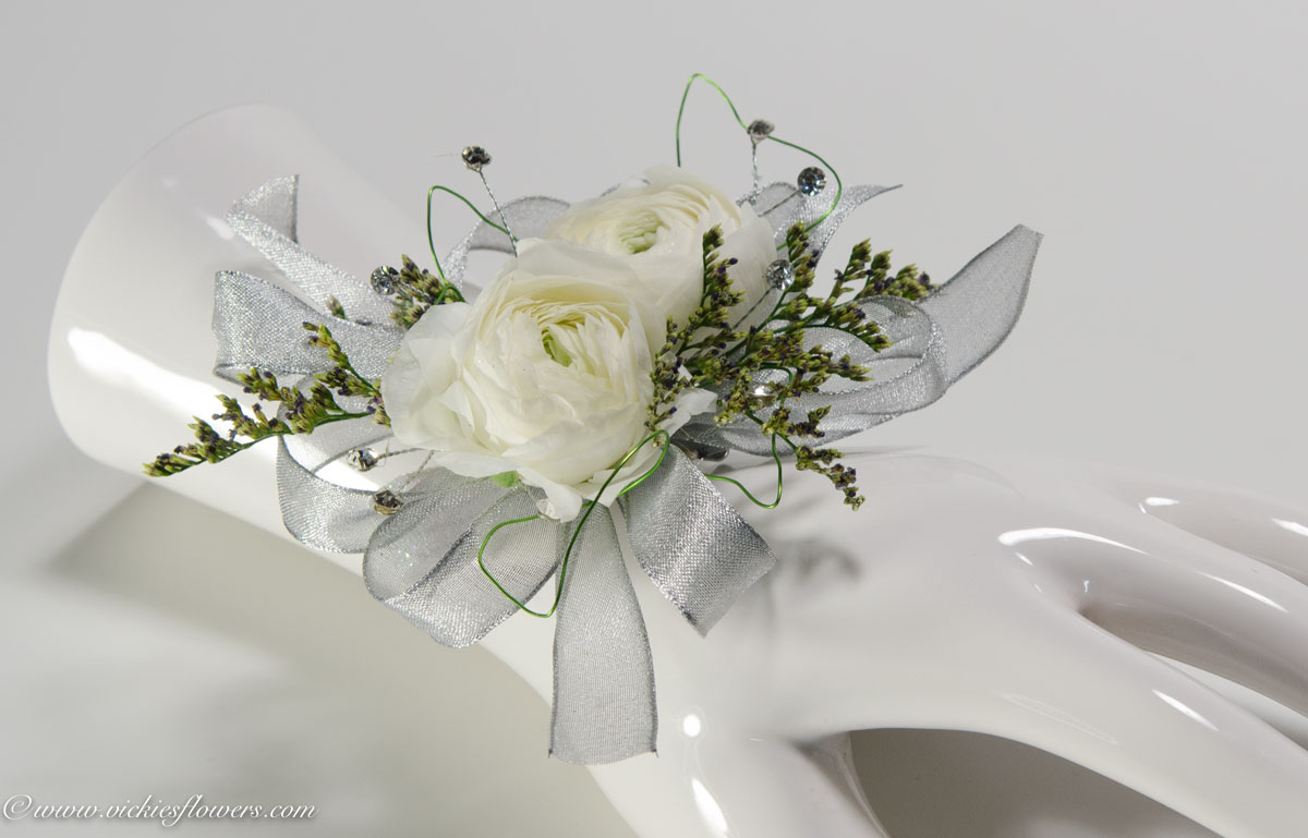 Corsage boutonnieres prom homecoming vickies flowers brighton prom 037 35 plus tax and delivery white and silver wrist corsage with white ranunculus sliver laced ribbon light blue jewels green wire mightylinksfo