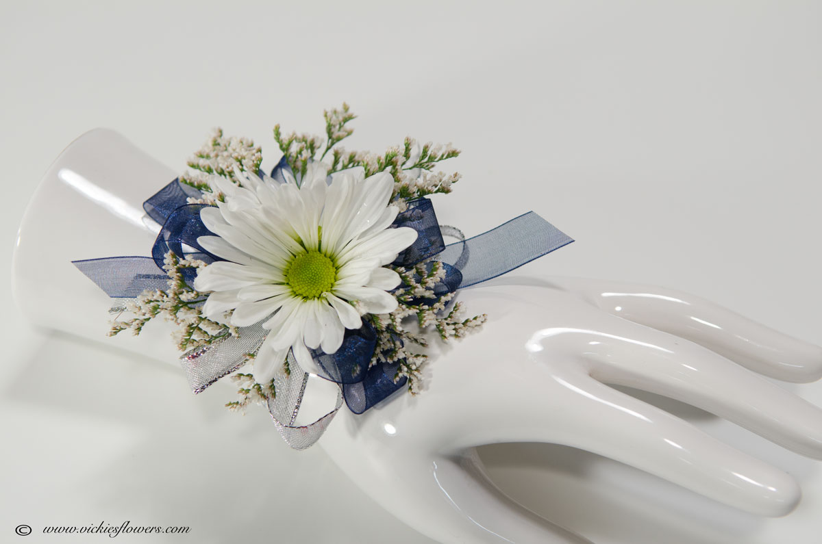 Corsage boutonnieres prom homecoming vickies flowers brighton prom 042 25 plus tax and delivery white and blue wrist corsage with white daisies blue ribbon and white limonium mightylinksfo