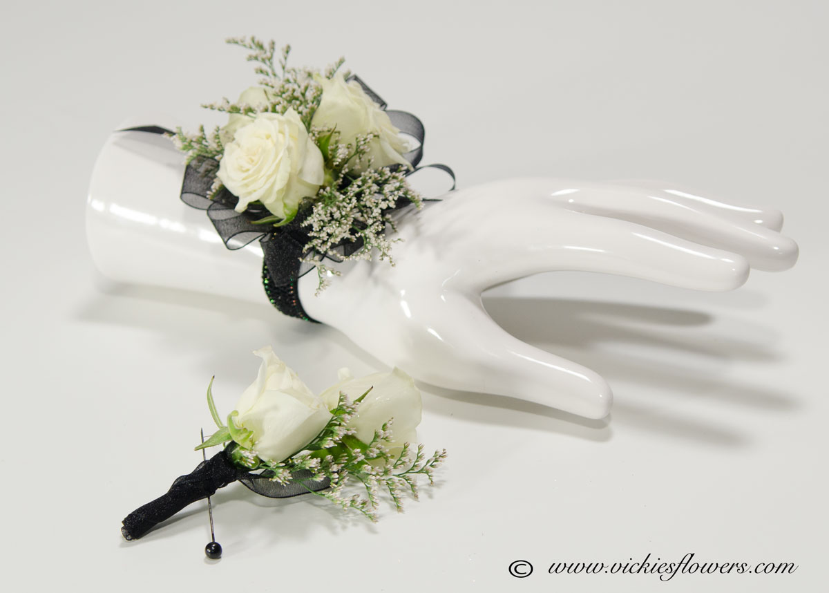 Corsage boutonnieres prom homecoming vickies flowers brighton prom 046 30 and boutonniere 20 plus tax and delivery white and black wrist corsage with matching boutonniere white spray roses black ribbon freerunsca Image collections