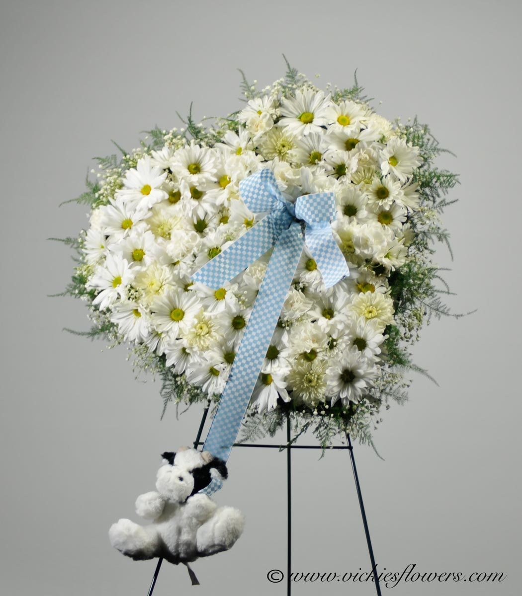 Funeral crosses standing sprays vickies flowers brighton co standing funeral spray 003 185 plus tax and delivery elegant white heart made with daisies and white mums blue ribbon attaches a stuffed animal izmirmasajfo