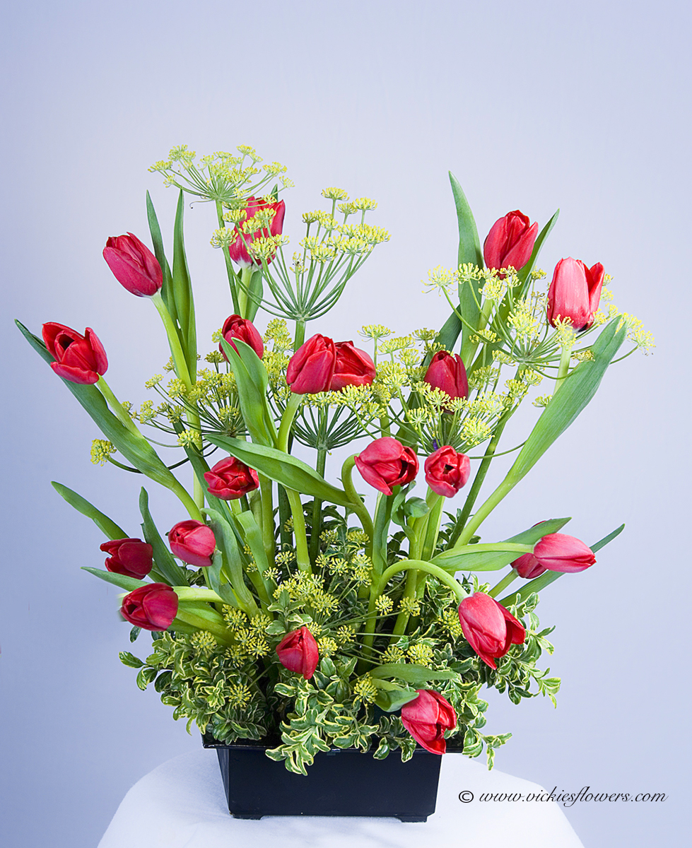 Ikebana Oriental Flowers IB - 016 $125 (plus tax and delivery) Beautiful ikebana arrangement with red Tulips and Queen Annes Lace in black container.