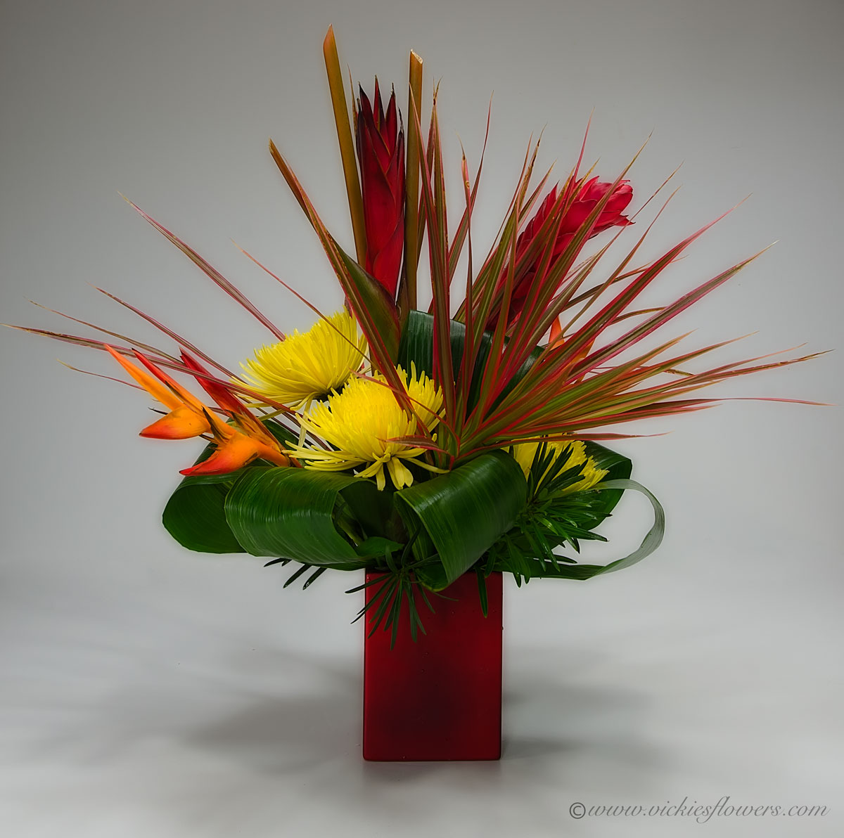 Ikebana asian flower arrangements vickies flowers brighton co ikebana oriental flowers ib 033 75 plus tax and delivery ikebana or sogetsu inspired tropical arrangement with red ginger and yellow mums in classy mightylinksfo