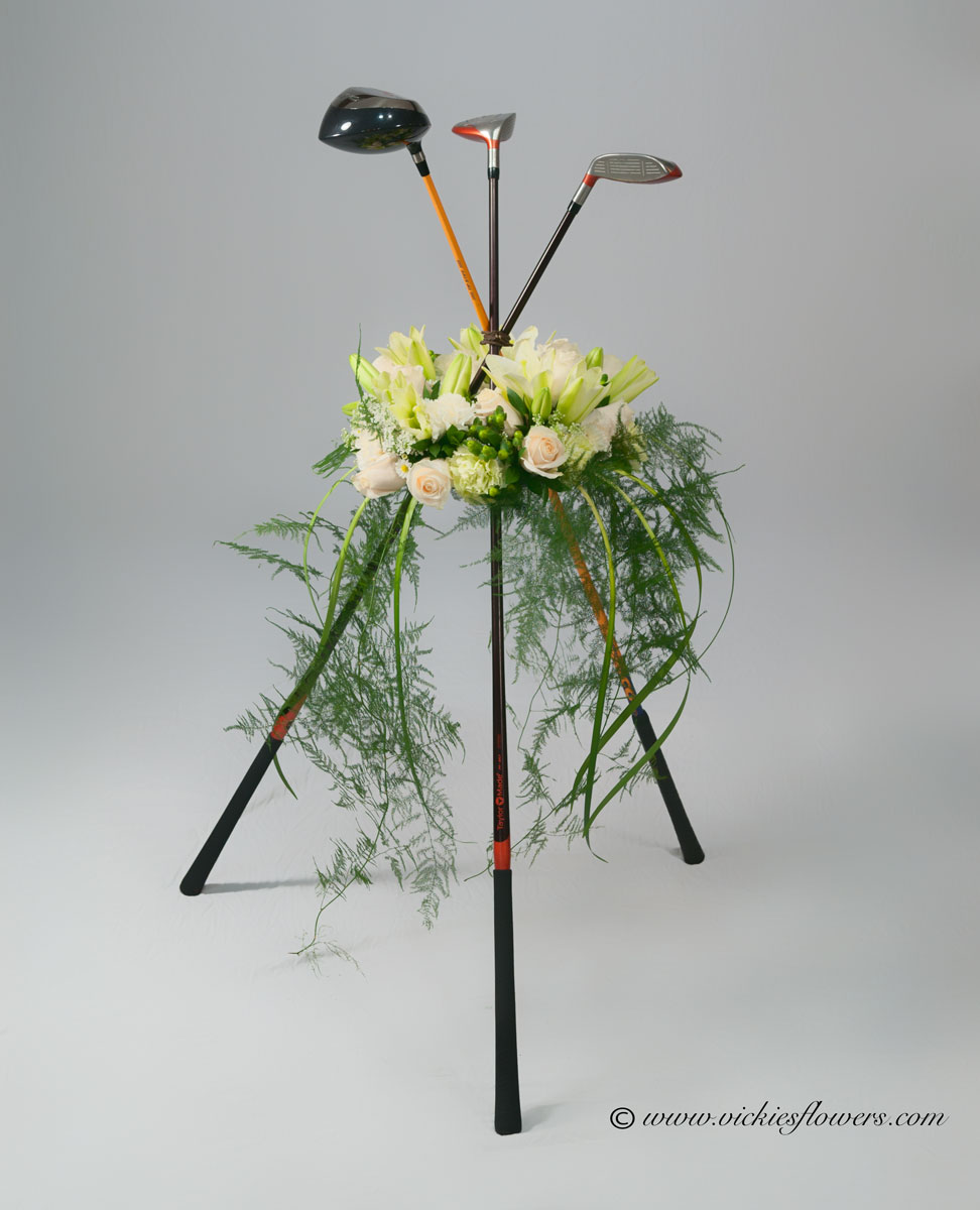 Broncos harley funeral flowers vickies flowers brighton co florist golf clubs from the deceased arranged with unique wreath memorialize the passion of your loved one with a golfing themed funeral arrangement izmirmasajfo
