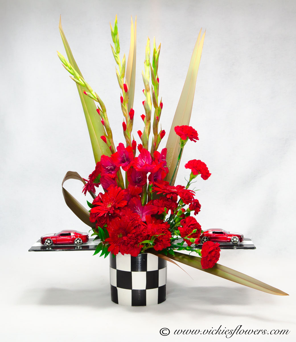 Broncos harley funeral flowers vickies flowers brighton co florist unique themed sympathy 023 150 plus tax and delivery red race car or muscle car tribute in a black and white checkered vase muscle cars are extending izmirmasajfo