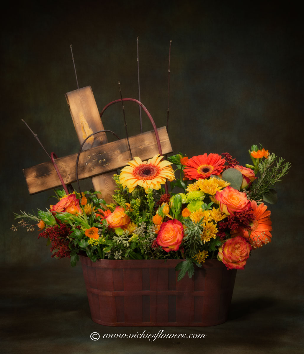 Broncos harley funeral flowers vickies flowers brighton co florist unique themed sympathy 026 195 plus tax and delivery flower basket with custom wooden cross flowers are arranged in a classic dark brown wicker basket izmirmasajfo