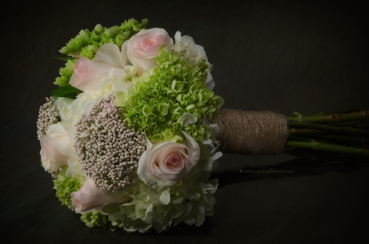 Wedding bouquets vickies flowers brighton colorado florist wb 010 beautiful studio photograph close up of a wedding bouquet flowers include green hydrangea white hydrangea pink roses and pink berries izmirmasajfo