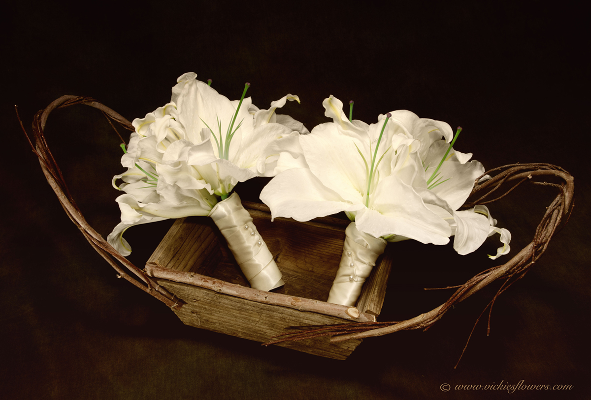 Wedding bouquets vickies flowers brighton colorado florist wb 018 white asiatic lily bridesmaids bouquets wrapped with white silk ribbon and pinned with pearl pins izmirmasajfo Image collections