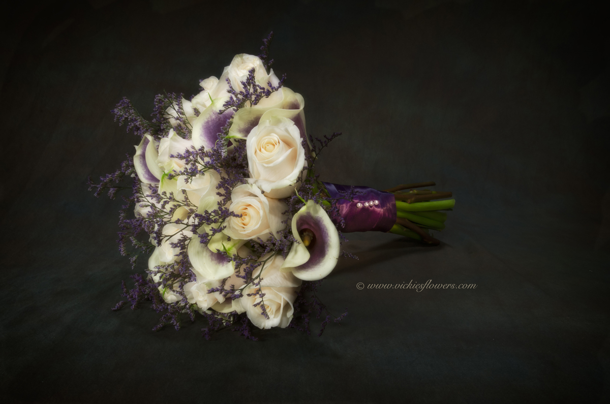 Wedding bouquets vickies flowers brighton colorado florist wb 020 bridal bouquet with white roses purple and white variegated calla lilies purple limonium wrapped with purple silk ribbon izmirmasajfo
