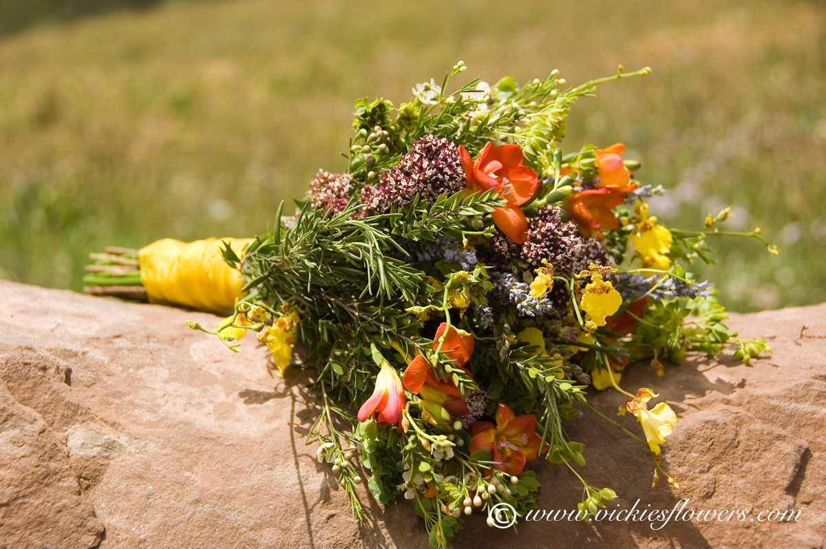 Wedding bouquets vickies flowers brighton colorado florist wb 029 wild flower wedding bouquet with orange yellow green and purple wild flowers flowers include orange freesia wax flowers and rosemary mightylinksfo