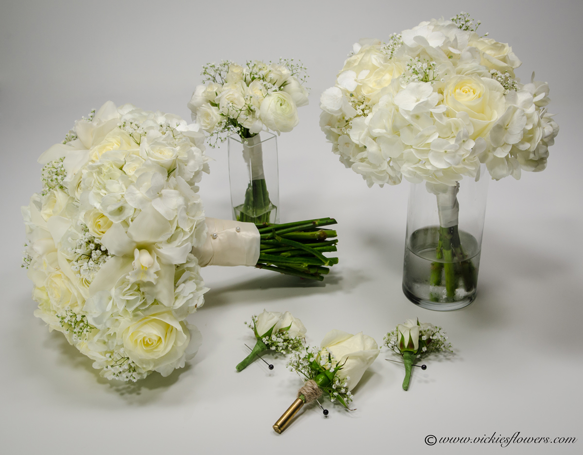 Wedding bouquets vickies flowers brighton colorado florist wb 034 white roses and phalaenopsis orchids wedding bouquets the matching bullet casing boutonniere izmirmasajfo