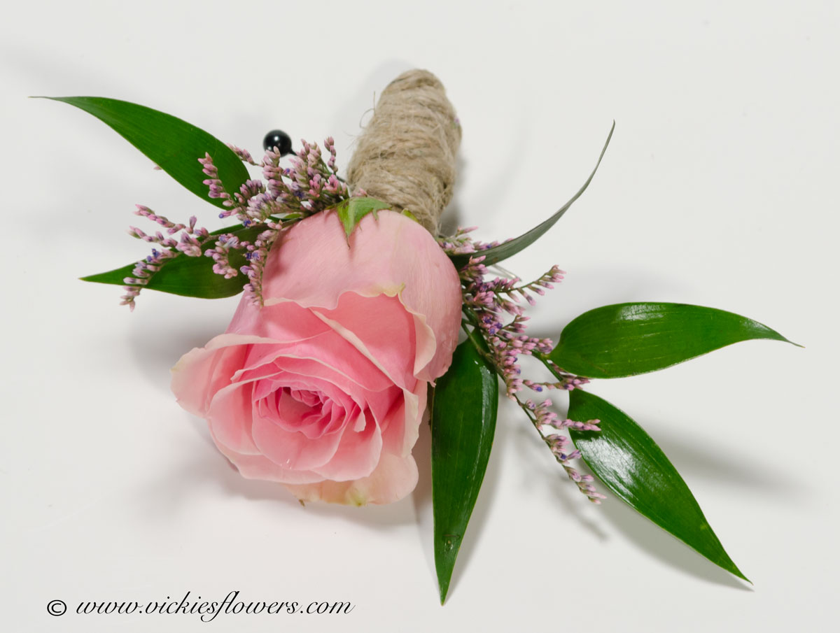 Wedding boutonniere vickies flowers brighton co florist boutonnieres for weddings 005 pink rose boutonniere accented with pink limonium and hand tied with twine junglespirit Images