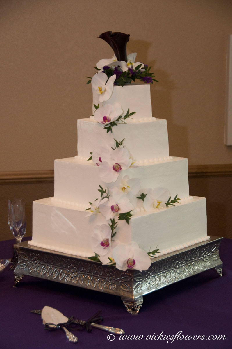 Wedding Cake Toppers 007 Cascading White Orchids On A 4 Tier With Dark Purple Calla Lily And Phalaenopsis Orchid