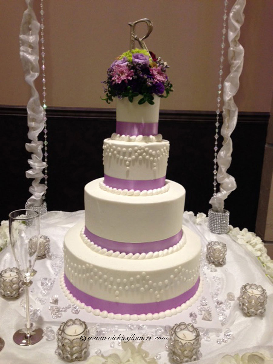 Wedding cake toppers vickies flowers brighton co florist wedding cake toppers 021 four tiered white wedding cake decorated with purple ribbon and flower topper with purple roses red roses green mightylinksfo