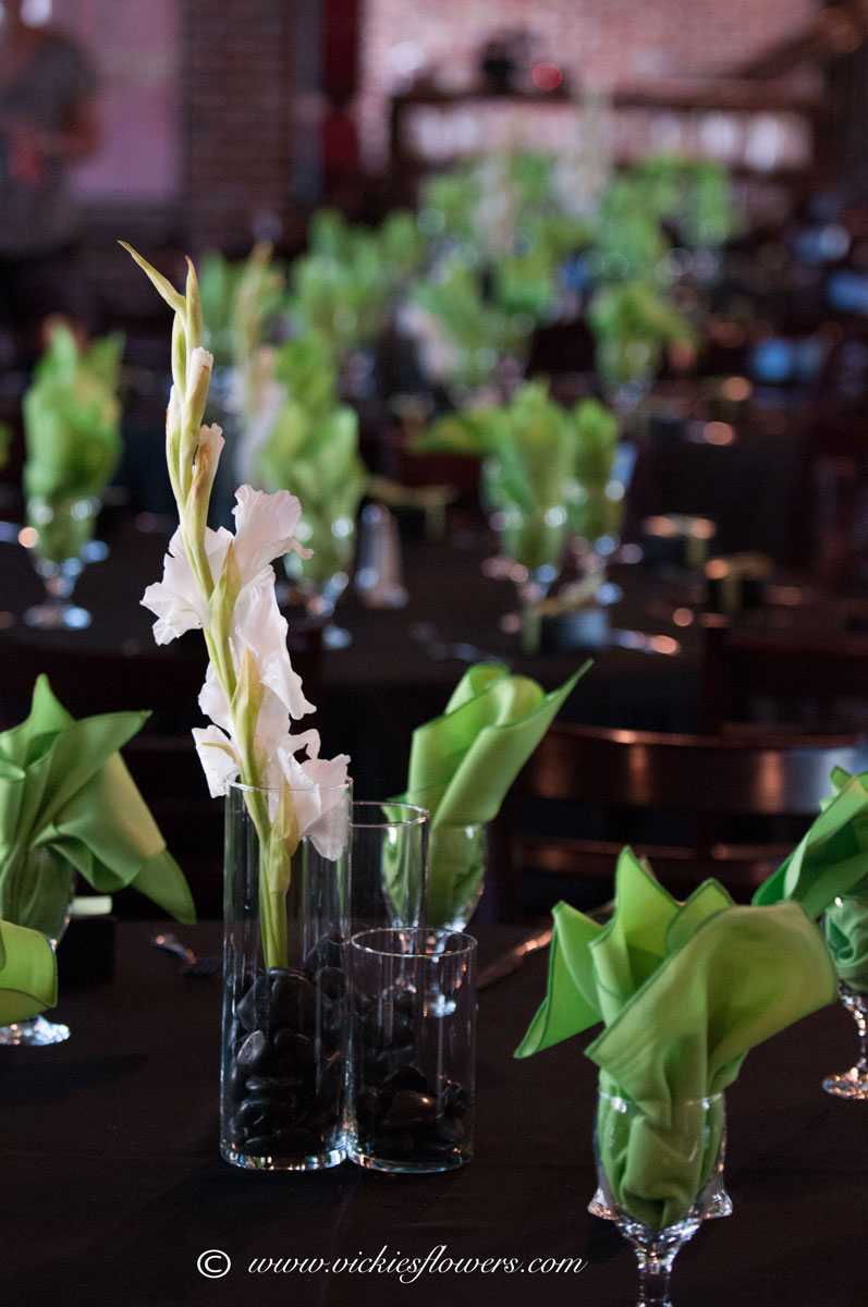 Wedding centerpieces vickies flowers brighton co florist wedding centerpieces 001 white gladiolas in glass cylinder vase accented with black river rocks perfect match with green decor and table setting mightylinksfo