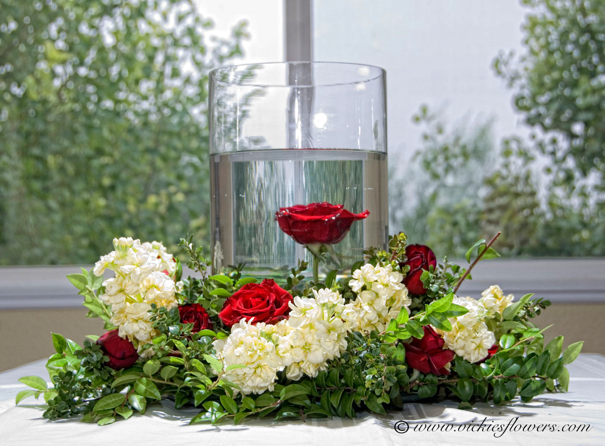 Wedding centerpieces vickies flowers brighton co florist wedding centerpieces 004 very large cylinder base with submerged red rose the vase is surrounded by red roses and white hydrangea accented with mixed mightylinksfo