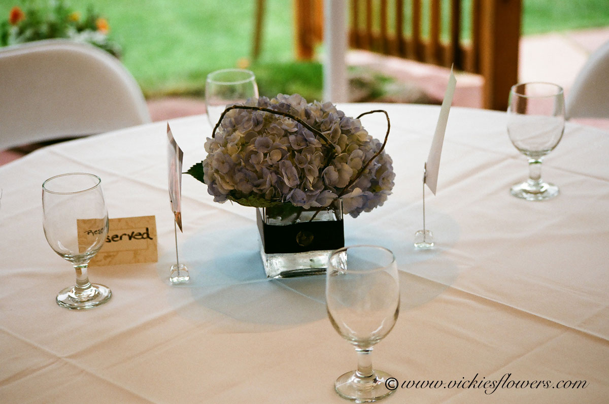 Wedding centerpieces vickies flowers brighton co florist wedding centerpieces 021 classy blue hydrangea in clear glass vase wrapped with dark purple ribbon reviewsmspy