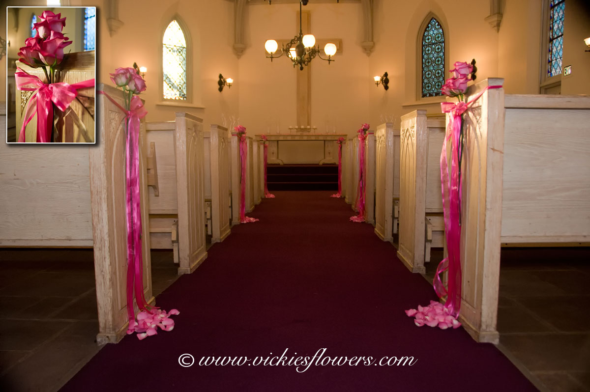 Wedding flowers vickies flowers brighton colorado florist wedding flower decorations 016 pew and isle decoration inside of church pew ends decorated with pink roses and hand tied with lite pink sheer ribbon junglespirit Images