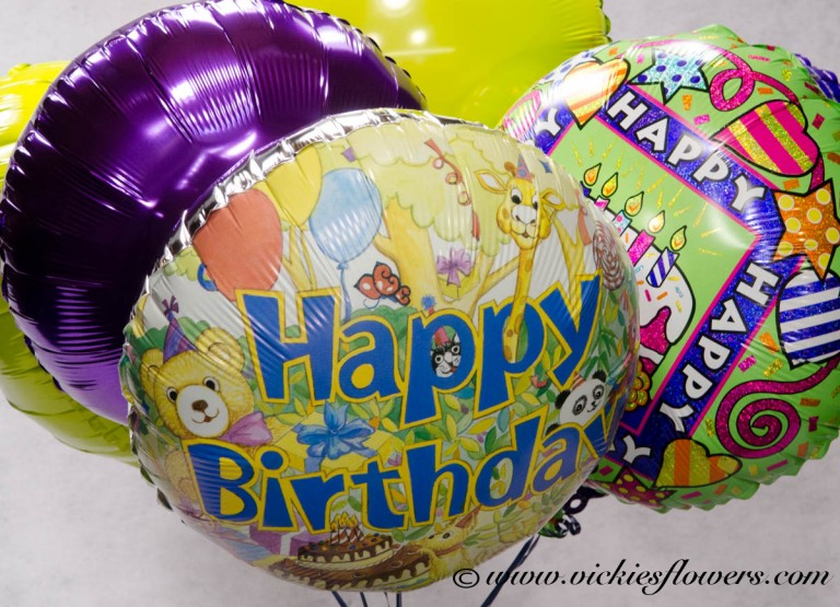 photograph of happy birthday balloons close up
