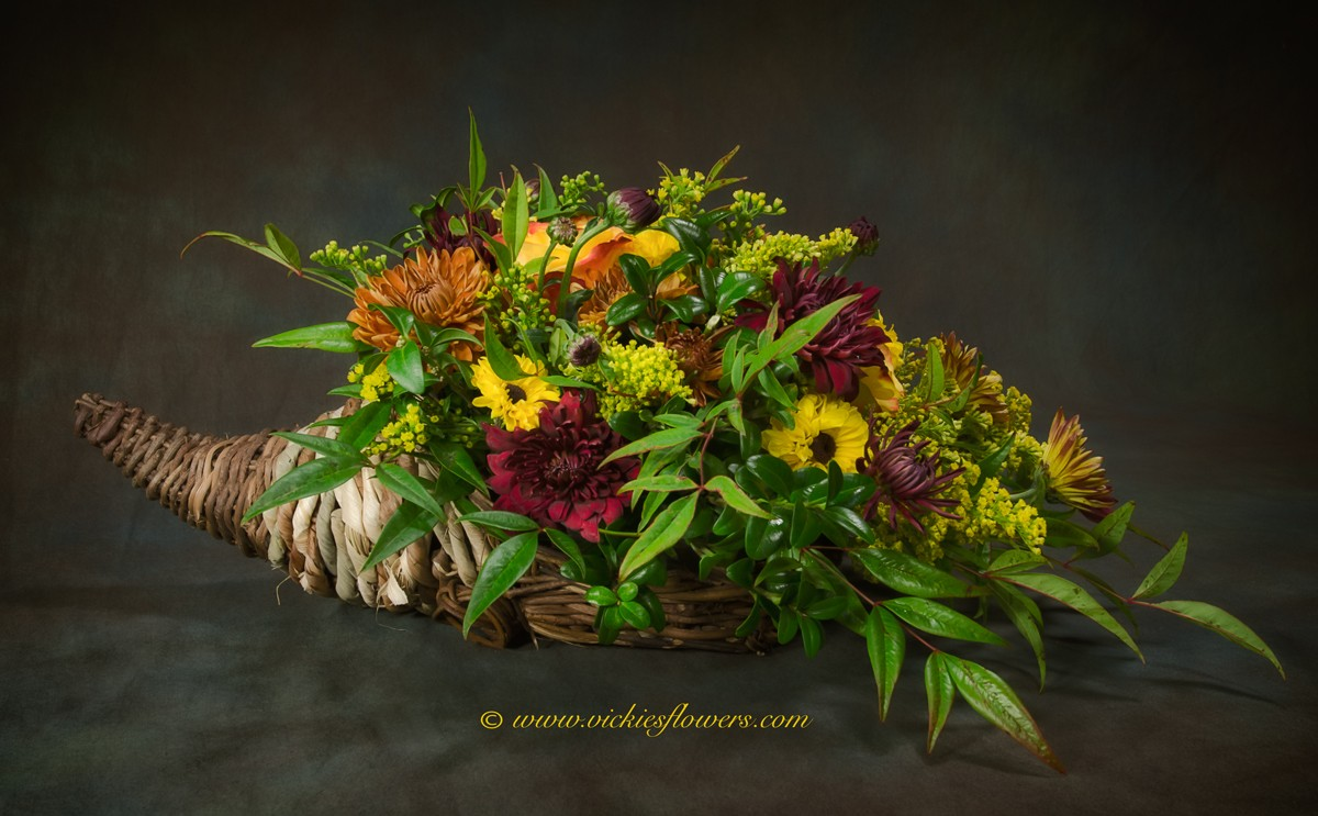Photograph of Thanksgiving cornucopia flower arrangement