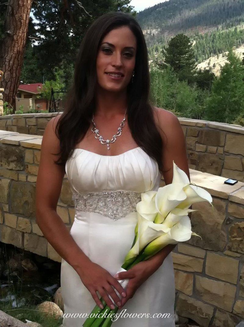 Photograph of bride holding a beautiful white Calla Lily wedding bouquet.