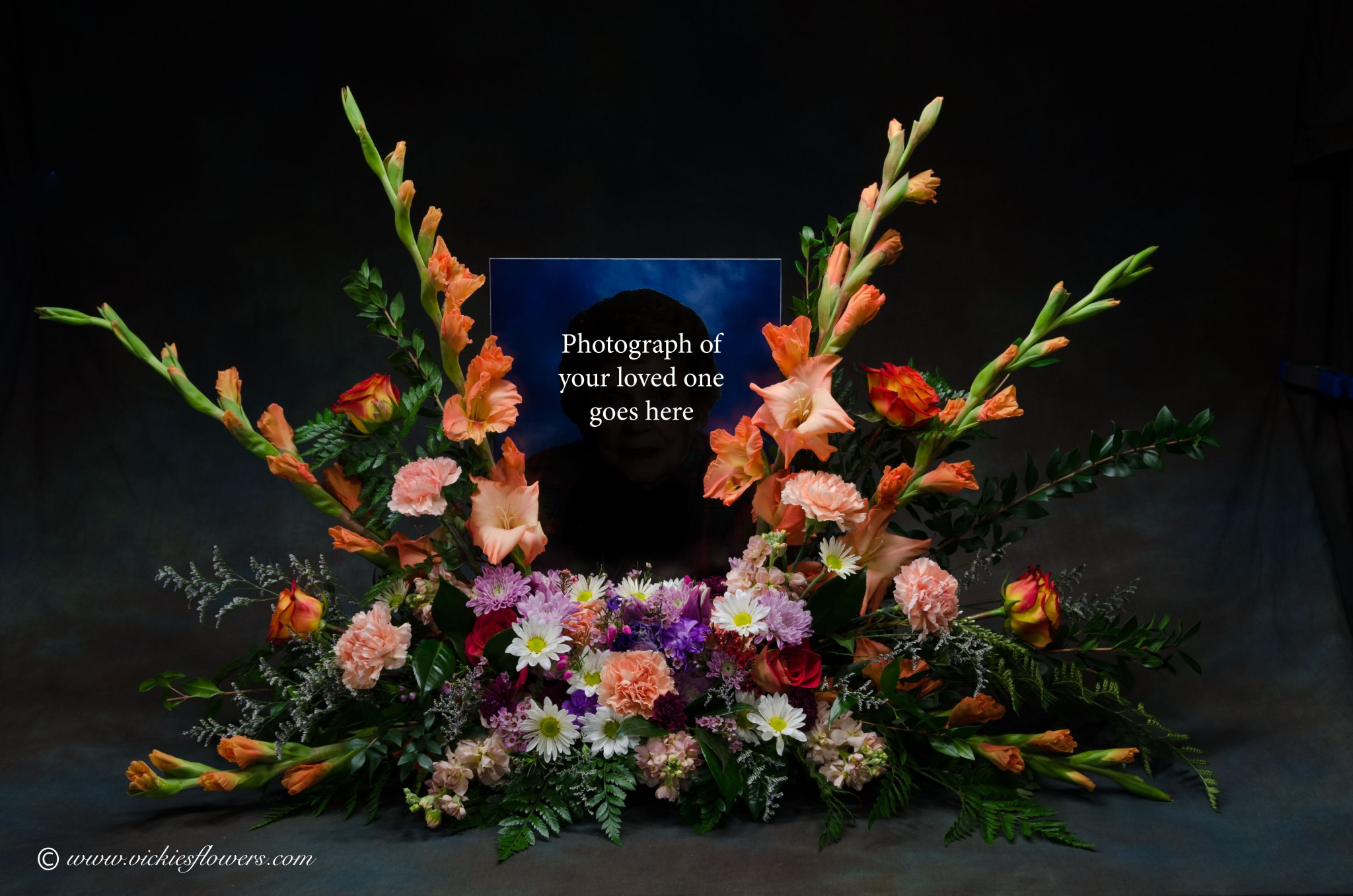 How to choose flowers for a funeral vickies flowers brighton co photograph of our very popular orange themed cremation with photograph arrangement flowers surround picture of izmirmasajfo