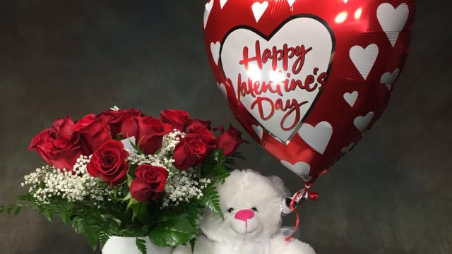 Photograph of The perfect combination for a complete valentines gift. 18 Roses, a Valentine balloon, and a cute Teddy Bear.