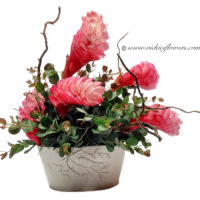 Photograph of ikebana flower arrangement with pink ginger