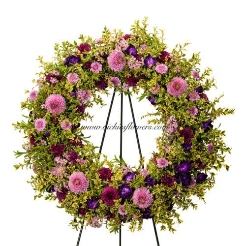 Picture of oval standing spray with pink and purple flowers